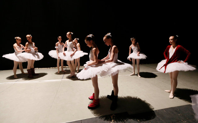 Students prepare for a performance by the graduates at the State Theatre of Opera and Ballet, at the Krasnoyarsk choreographic college in the Siberian city of Krasnoyarsk, Russia, May 4, 2017. (Photo by Ilya Naymushin/Reuters)