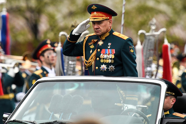 Russian Defence Minister Sergei Shoigu salutes as he reviews units during the Victory Day military parade at Red Square in Moscow on May 9, 2017. (Photo by Kirill Kudryavtsev/AFP Photo)
