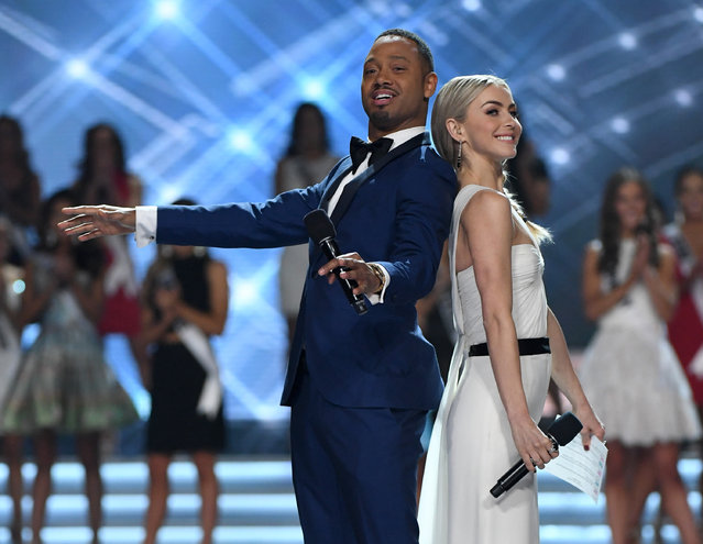 Co-hosts Terrence J (L) and Julianne Hough joke around during the 2017 Miss USA pageant at the Mandalay Bay Events Center on May 14, 2017 in Las Vegas, Nevada. (Photo by Ethan Miller/Getty Images)