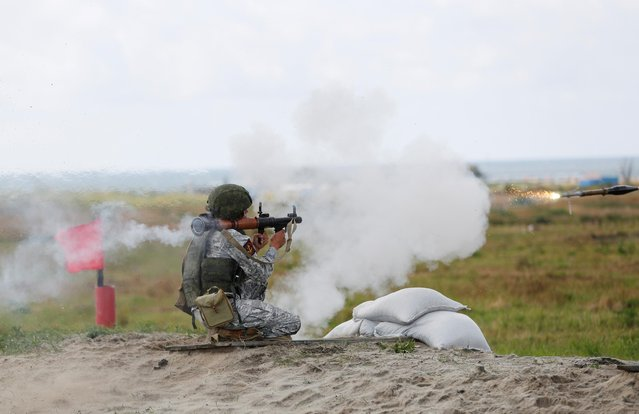 A marine from Russia fires as he takes part in the International Army Games 2019 at the at Khmelevka firing ground on the Baltic Sea coast in Kaliningrad Region, Russia on August 8, 2019. (Photo by Vitaly Nevar/Reuters)