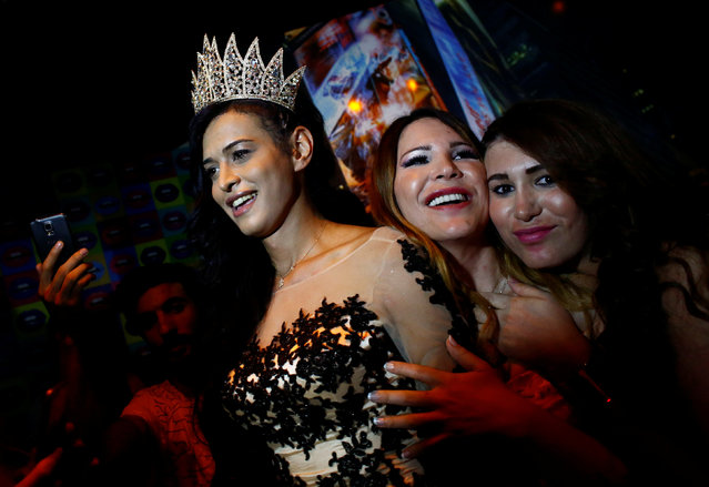 Rosalinda Peres poses with her friends after winning the Angel of Turkey transgender/transsexual beauty pageant in Istanbul, Turkey, late May 26, 2016. (Photo by Murad Sezer/Reuters)