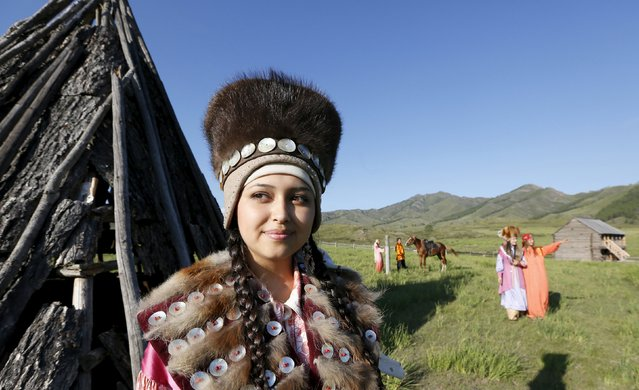 Models dressed in Khakas national costumes perform during the reconstruction of daily life and traditional holidays celebrated by indigenous population of the Republic of Khakassia during a demonstration for visitors at a museum preserve outside Kazanovka village, southwest of the city of Abakan, Russia, July 24, 2015. (Photo by Ilya Naymushin/Reuters)
