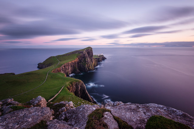 """""""Lighhouse"""". After several days of rain finally got to witness a beautiful sunset at Neist Point Lighthouse and I could take this picture at dusk. The image was made in mid-August of last summer on the island of Skye in Scotland with the use of a tripod and ND filter, wait a few minutes was enough to make this characteristic shot. Photo location: Isle of Skye, Scotland. (Photo and caption by Stefano Coltelli/National Geographic Photo Contest)"""