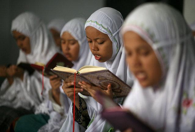 Students read Quran on the first day of the holy fasting month of Ramadan at Ar-Raudlatul Hasanah Islamic boarding school in Medan, North Sumatra, Indonesia, Monday, June 6, 2016. (Photo by Binsar Bakkara/AP Photo)