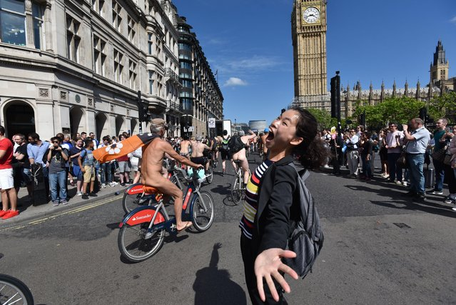 People take part in the World Naked Bike Ride 2017 across Westminster Bridge in central London on June 10, 2017. (Photo by Matthew Chattle/Rex Features/Shutterstock)
