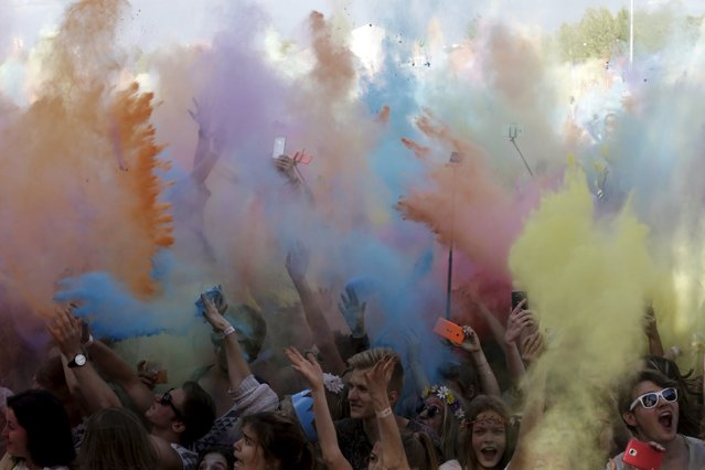 People attend the Holi festival, or the Festival of Colors, in Riga, Latvia, August 1, 2015. (Photo by Ints Kalnins/Reuters)