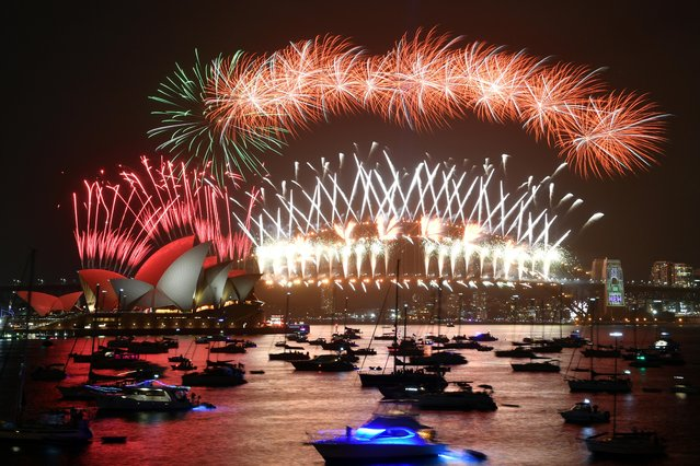 The midnight fireworks are seen from Mrs Macquarie's Chair during New Year's Eve celebrations in Sydney, Australia on January 1, 2020. (Photo by Mick Tsikas/AAP Image for City of Sydney via Reuters)