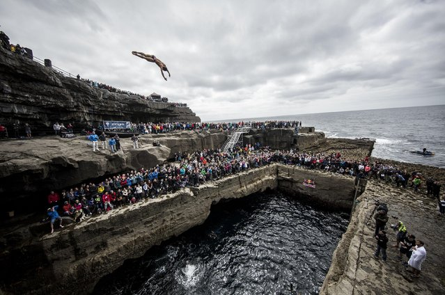 In this handout image provided by Red Bull, David Colturi of the USA dives from the 27.5 metre platform at the Serpent`s Lair during the first stop of the Red Bull Cliff Diving World Series on June 24, 2017 on Inis Mor, Ireland. (Photo by Dean Treml/Red Bull via Getty Images)