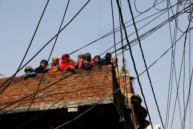 Relatives and neighbours of Mohsin, who died during clashes with police following protests against a new citizenship law, stand on the roof their house in Meerut, in the northern state of Uttar Pradesh, India, December 24, 2019. (Photo by Adnan Abidi/Reuters)