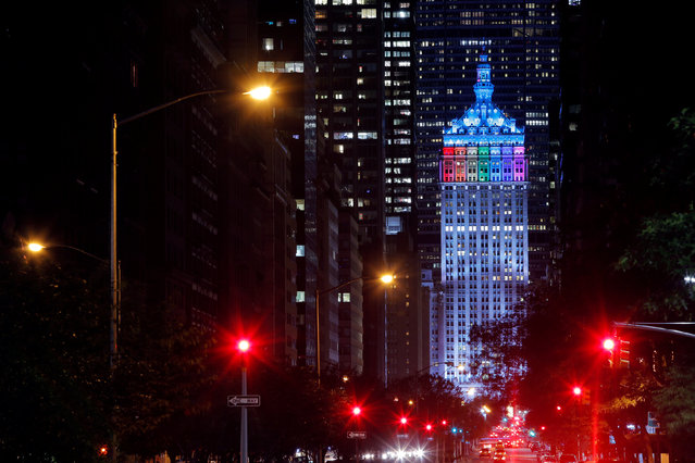 The Helmsley Building is lit in rainbow colors to honor the victims of the Orlando shooting massacre at the Pulse nightclub, in the Manhattan borough of New York, U.S., June 14, 2016. (Photo by Andrew Kelly/Reuters)