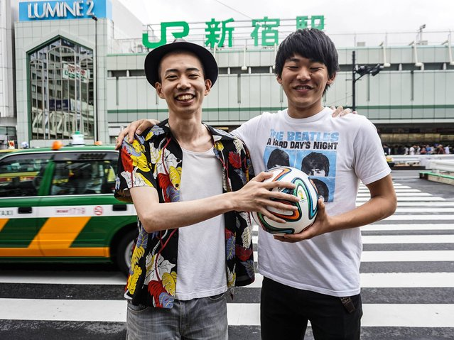 Japan: Portraits of people gathered for the FIFA World Cup express that even strangers can be united – all over a ball. (Photo by Taro Karibe)