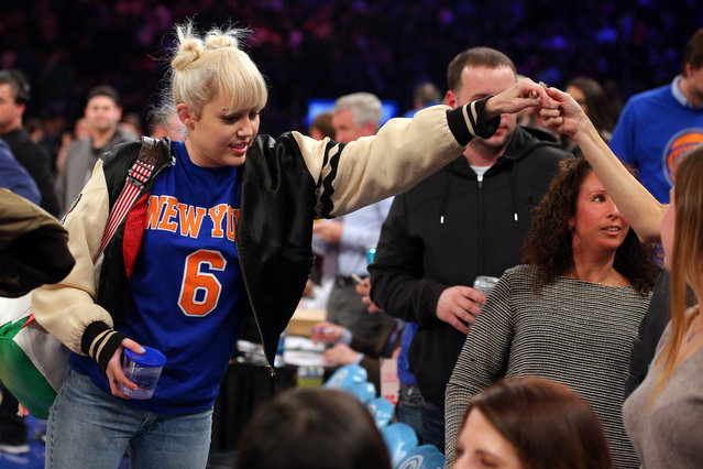 Miley Cyrus shakes hands with fans during halftime between the  Knicks and the Cavs at Madison Square Garden, 2016. (Photo by Brad Penner/USA TODAY Sports)