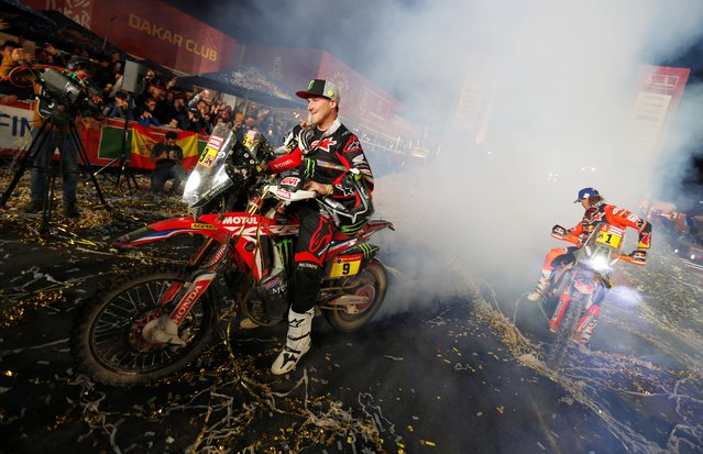 Monster Energy Honda Team 2020'S Ricky Brabec celebrates after winning the bike race of the Dakar Rally in Saudi Arabia on January 17, 2020. Brabec is the first American to win the Dakar on two wheels since the gruelling endurance event started in 1979. Brabec had started four previous Dakars but this race was only his second finish. (Photo by Hamad I Mohammed/Reuters)