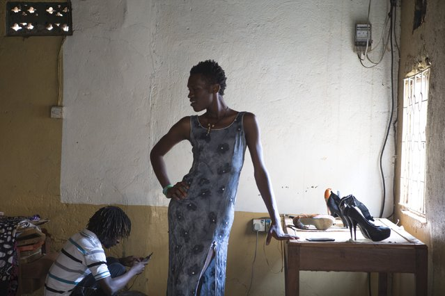 """Alicia, a participant of the Mr and Miss Pride beauty contest, strikes a pose after walking the runway during rehearsals for the contest in Kampala, Uganda, August 1, 2015. """"I am contesting for Miss Pride to fight against discrimination of the LGBTI community in Uganda"""", Alicia said. Homosexuality is taboo in almost all African countries and illegal in most including Uganda, where rights groups say gay people have long risked jail. (Photo by Edward Echwalu/Reuters)"""