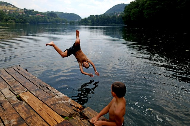 Boys jump into a lake in the central Bosnian town of Jajce, Bosnia and Herzegovina, August 5, 2015. (Photo by Dado Ruvic/Reuters)
