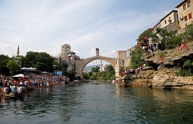 A competitor jumps from the Old Bridge during Red Bull Cliff Diving Competition in Mostar, Bosnia and Herzegovina on August 15, 2015. (Photo by Dado Ruvic/Reuters)