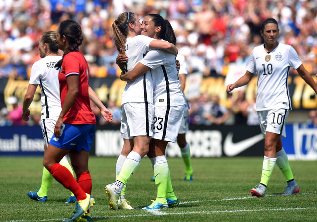 United States' midfielder Heather O'Reilly (9) celebrates with Christen Press (23) after Press' goal during the first half of a women's friendly soccer match against Costa Rica on Sunday, August 16, 2015, in Pittsburgh. (Photo by Don Wright/AP Photo)