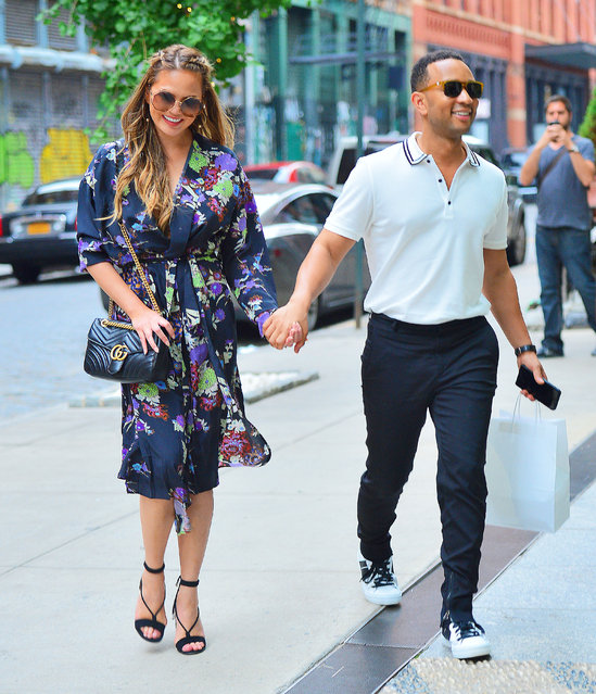 Chrissy Teigen and John Legend are all smiles as they hold hands while taking a stroll in New York City, NY on July 29, 2017. (Photo by Splash News and Pictures)