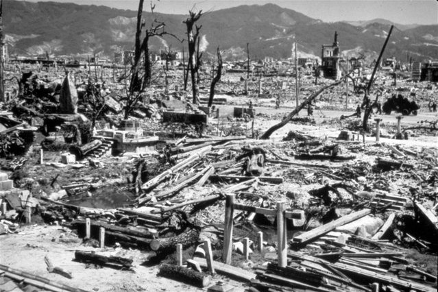 This August 6, 1945 file photo,  shows the destruction from the explosion of an atomic bomb in Hiroshima, Japan. The 70th anniversary of the atomic bombings of Hiroshima and Nagasaki are being marked with memorial services, peace concerts and art exhibits. More than 200,000 people died in the two blasts, which were the first wartime uses of nuclear weapons and which led to Japan's surrender and the end of World War II. (Photo by AP Photo)