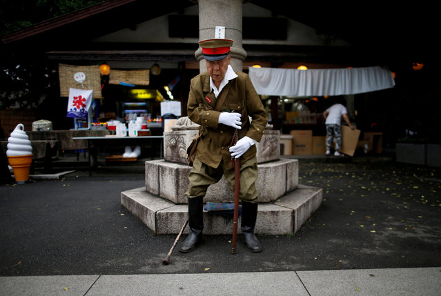 A man dressed as a Japanese imperial army soldier stands at Yasukuni Shrine in Tokyo, Japan August 15, 2017, to mark the 72nd anniversary of Japan's surrender in World War Two. (Photo by Issei Kato/Reuters)