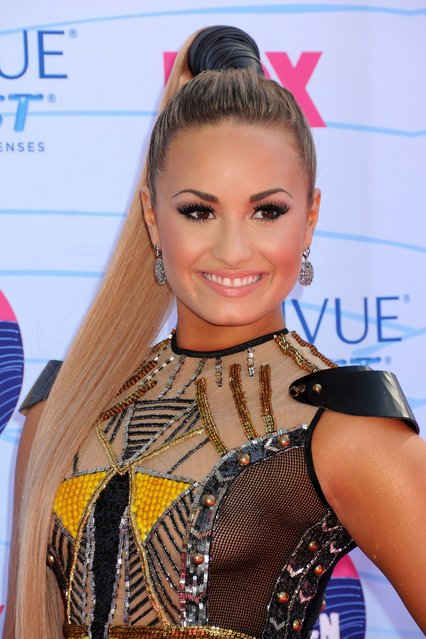 Singer/actress Demi Lovato arrives at the 2012 Teen Choice Awards at Gibson Amphitheatre on July 22, 2012 in Universal City, California. (Photo by Jason Merritt)