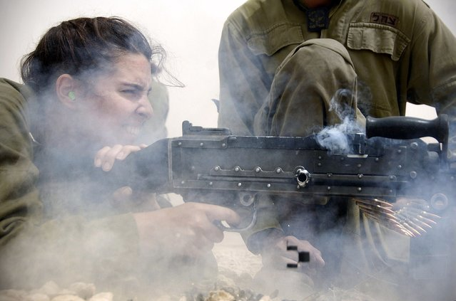 """IDF Female Infantry Instructor Takes it All Out with Her Machine Gun"", May 17, 2011. IDF female infantry instructor tests her shooting ability by taking it all out with her machine gun. Today 90% of all military positions are available to women in the IDF. Karakal is a unisex combat unit which operates along the southern border of Israel. The elite dog unit, Oketz, is open to women, as well as various artillery and armored divisions. In 2006, during the Second Lebanon War, women were involved in field operations alongside men for the first time since the 1948 War of Independence."