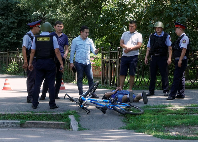 Police officers detain a man after an attack in the centre of Almaty, Kazakhstan, July 18, 2016. A gunman who killed three policemen and a member of the public in Kazakhstan on Monday may have been an Islamist militant, the president Nursultan Nazarbayev has said. Suspect Ruslan Kulikbayev, 26, became close to Salafists – ultra-conservative Muslims – when serving a prison sentence, security officials said. (Photo by Shamil Zhumatov/Reuters)