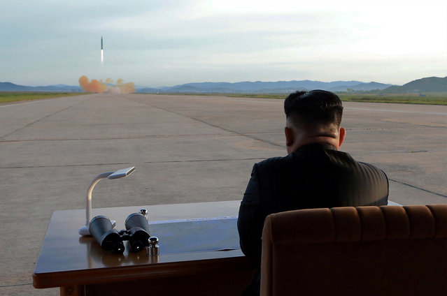 North Korean leader Kim Jong Un watches the launch of a Hwasong-12 missile in this undated photo released by North Korea's Korean Central News Agency (KCNA) on September 16, 2017. (Photo by Reuters/KCNA)