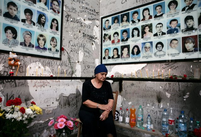 A woman mourns during a ceremony commemorating the people who died during the 2004 Beslan hostage crisis at the southern Russian town's School Number One in Beslan, September 3, 2008. Moscow's campaign against Islamist insurgents reached a watershed in September 2004, when heavily armed Chechen gunmen seized a school in Beslan. When the siege ended three days later, 334 people – half of them children – were dead. (Photo by Kazbek Basayev/Reuters)