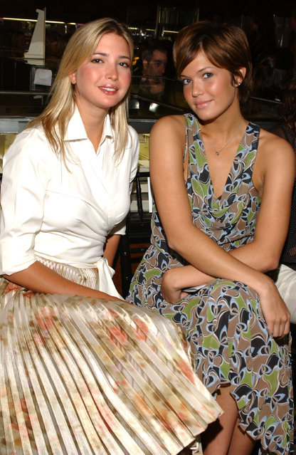 Ivanka Trump (L) and Mandy Moore sit in the front row during the Spring 2005 show during Olympus Fashion Week at Tiffany's September 12, 2004 in New York City. (Photo by Trish Lease/Getty Images)