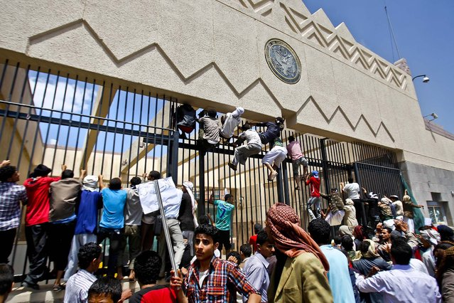 Protesters storm the gate of the U.S. Embassy in Sanaa, Yemen on Thursday. (Photo by Hani Mohammed/Associated Press)