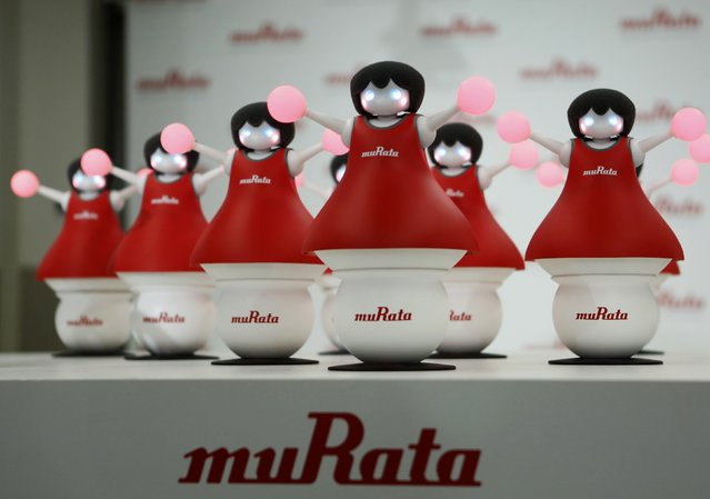 "Japan's Murata Manufacturing Co. Ltd's latest concept robots, ""The Murata Cheerleaders"", which balance on balls and synchronize as a team by utilizing its latest sensing and communication technology, are displayed during an unveiling event in Tokyo September 25, 2014. (Photo by Yuya Shino/Reuters)"