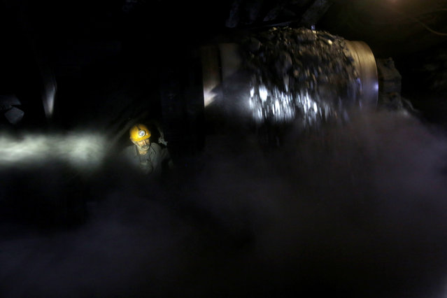 In this Tuesday, August 19, 2014 photo, an Iranian coal miner works inside a mine near the city of Zirab 212 kilometers (132 miles) northeast of the capital Tehran, on a mountain in Mazandaran province, Iran. (Photo by Ebrahim Noroozi/AP Photo)