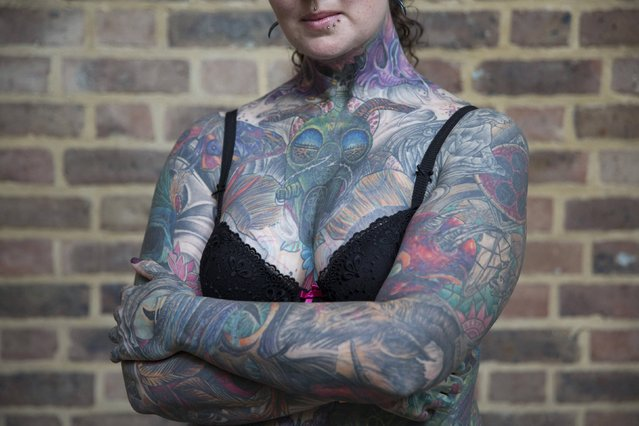 Victoria Clarke poses with her tattoos during the 10th International Tattoo Convention in London September 27, 2014. (Photo by Neil Hall/Reuters)