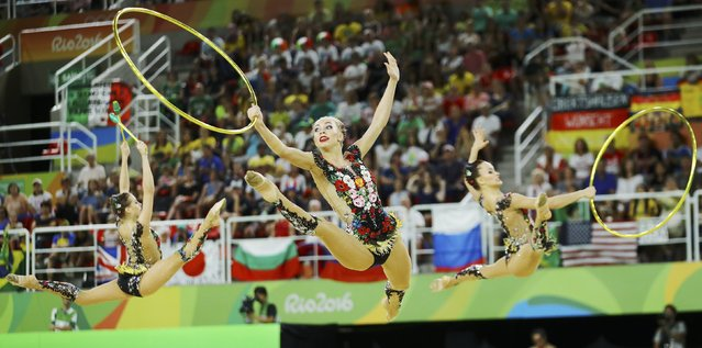 2016 Rio Olympics, Rhythmic Gymnastics, Preliminary, Group All-Around Qualification, Rotation 1, Rio Olympic Arena, Rio de Janeiro, Brazil on August 20, 2016. Team Russia (RUS) compete using clubs and hoops. (Photo by Mike Blake/Reuters)