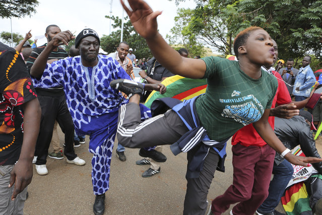 Euphoric crowds march and dance on the streets of Harare, demanding the departure of President Robert Mugabe, Saturday November 18, 2017. The military, which put Mugabe under house arrest this week, has approved the demonstration that includes people from across the political spectrum. (Photo by Tsvangirayi Mukwazhi/AP Photo)