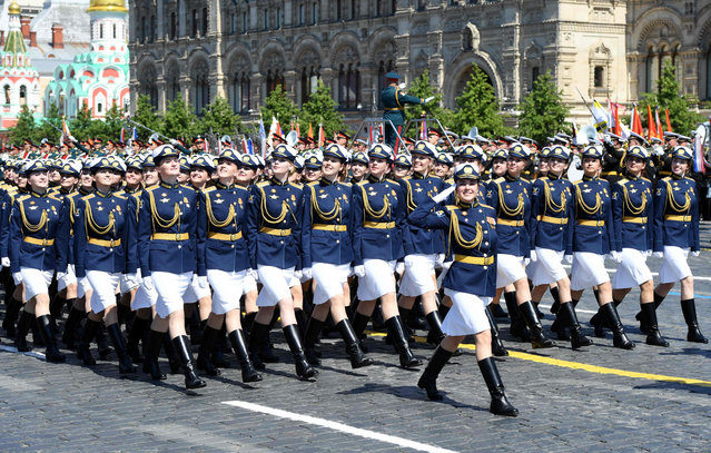 This handout picture provided by Host photo agency shows Russian servicewomen marching on Red Square during a military parade, which marks the 75th anniversary of the Soviet victory over Nazi Germany in World War Two, in Moscow on June 24, 2020. The parade, usually held on May 9, was postponed this year because of the coronavirus pandemic. (Photo by Sergey Pyatakov/Host Photo Agency/AFP Photo)