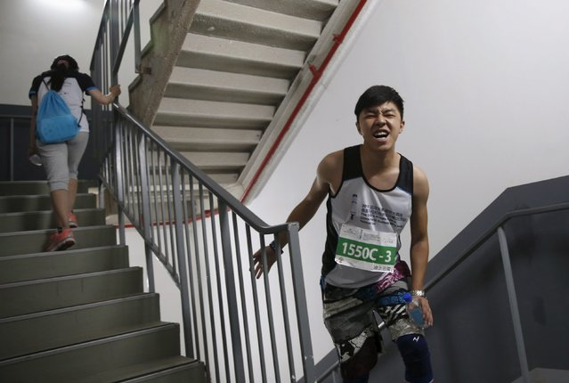 A exhausted participant reacts during a vertical run event at China World Summit Wing hotel in Beijing, China, September 19, 2015. (Photo by Kim Kyung-Hoon/Reuters)