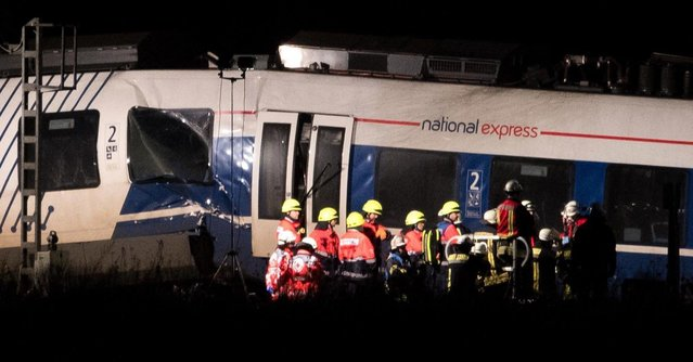 Emergency crews stand near the wreckage of two trains that collided in Meerbuesch-Osterath district on December 5, 2017 in Dusseldorf, Germany.According to German state railways Deutsche Bahn, the collision involved a freight train and a regional commuter train leaving at least 50 people injured. (Photo by Lukas Schulze/Getty Images)