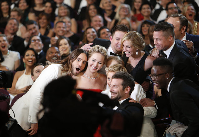Ellen DeGeneres gathers members from the audience for a selfie, from   backstage at the 86th Annual Academy Awards on Sunday, March 2, 2014 at the Dolby Theatre at Hollywood & Highland Center in Hollywood,  CA. (Photo by Al Seib/Los Angeles Times)
