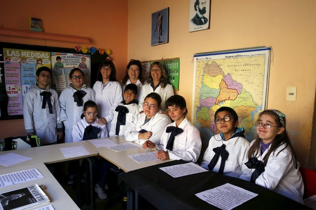 Laura Paipo (top row right), first blind principal in Uruguay poses with students and co-workers at special school 279 in Montevideo, September 18, 2015. (Photo by Andres Stapff/Reuters)