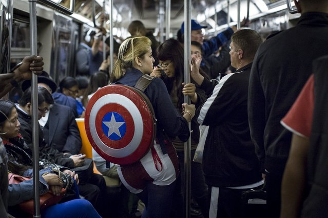 A woman in costume rides the subway at the conclusion of the first day of New York Comic Con in Manhattan, New York, October 8, 2015. (Photo by Andrew Kelly/Reuters)