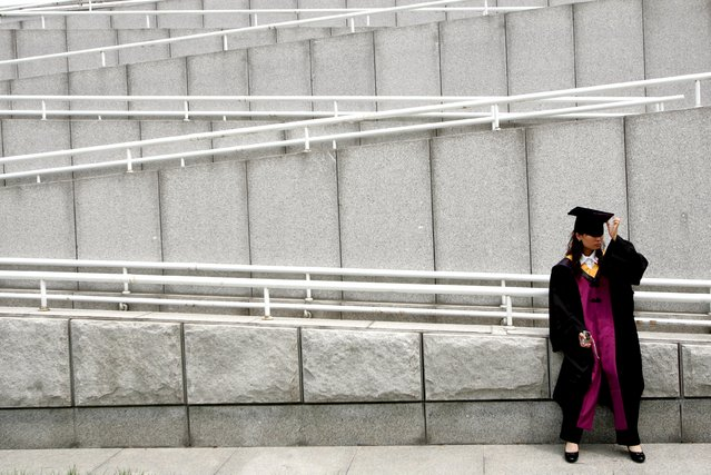 A student adjusts her cap after a graduation ceremony at Tsinghua University in Beijing, in this July 11, 2006 file photo. A billion-dollar Chinese plan to invest in Western Digital Corp is designed to plug the U.S. data storage firm into a network of influential China tech players carefully constructed by Tsinghua University, the alma mater of President Xi Jinping. (Photo by Jason Lee/Reuters)