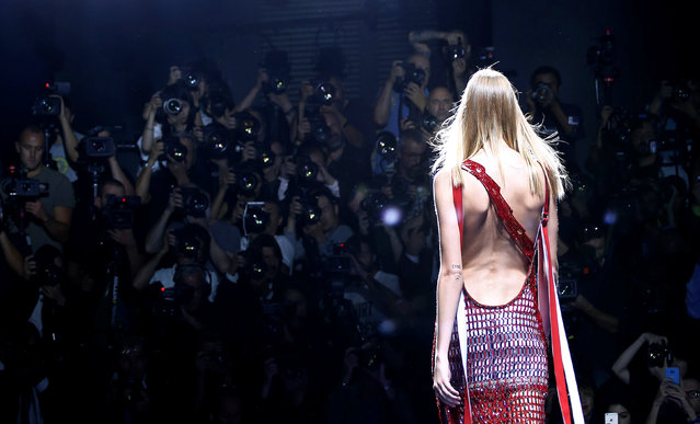 A Model presents a creation at the Versace fashion show during Milan Fashion Week Spring/Summer 2017 in Milan, Italy, September 23, 2016. (Photo by Alessandro Garofalo/Reuters)