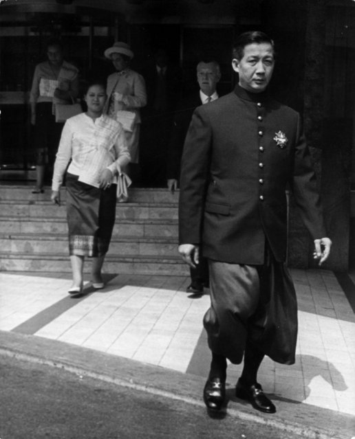 Crown Prince Vong Savang (1931 - 1980?) of Laos accompanied by his wife Princess Manilay, leave the Royal Garden Hotel, Kensington, to lunch with the Queen at Buckingham Palace, 7th May 1970. The date of his death is uncertain because he died without acknowledgement in a Communist re-education camp along with his parents. (Photo by Michael Webb/Keystone/Getty Images)