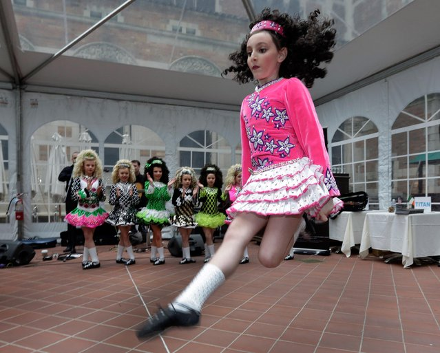 Members of the Petri School of Irish Dance perform at the Ireland Chamber of Commerce 17th annual St. Patrick's Day Breakfast, in New York, Saturday, March 16, 2013. The Irish, their descendants and the Irish for the day prepared to don green and pay tribute to Hibernian heritage as a weekend of St. Patrick's Day celebrations was set from New York's Fifth Avenue to the Louisiana bayou to Dublin's Parnell Square. (Photo by Richard Drew/AP Photo)