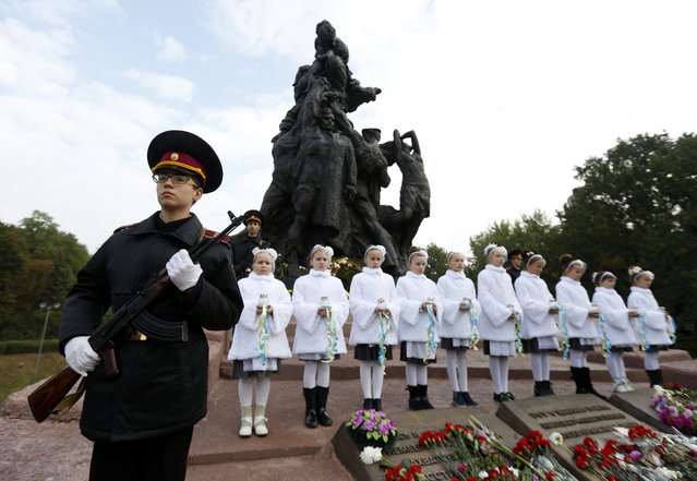 Kiev Cadets honor guard takes part in commemorative events at the Babi Yar ravine where Nazi troops machine-gunned tens of thousands of Jews during WWII, in Kiev, Ukraine, Thursday, September 29, 2016. Ukraine commemorated the 75th anniversary of the 1941 Babi Yar massacre. (Photo by Sergei Chuzavkov/AP Photo)