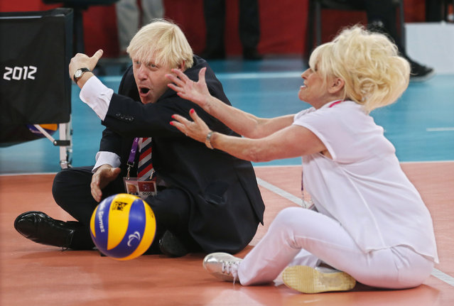 British actress Barbara Windsor (L) and London Mayor Boris Johnson play sitting volleyball at the London 2012 Paralympic Games August 31, 2012. (Photo by Suzanne Plunkett/Reuters)