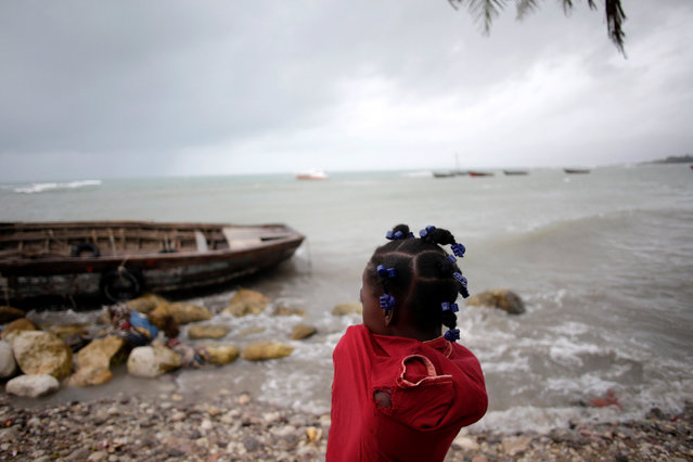A girl looks at anchored boats as Hurricane Matthew approaches in Les Cayes, Haiti, October 3, 2016. (Photo by Andres Martinez Casares/Reuters)