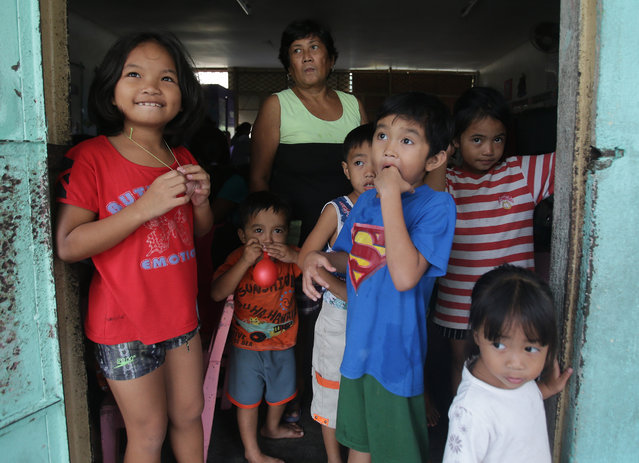 Young evacuees stay at a school as they take shelter from Typhoon Hagupit in Legazpi, Albay province, eastern Philippines on Sunday, December 7, 2014. (Photo by Aaron Favila/AP Photo)